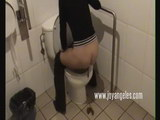 porn girl on the toilet taking a dump