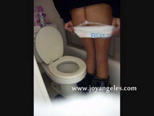 lady farting and pooping on the toilet