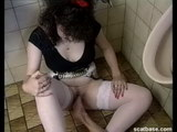girl peeing in a toilet
