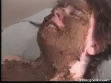 hairy mature slut gets scat in her face