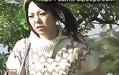 Outdoor pooping young Japanese woman