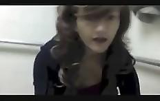 Cute teen girl shitting on toilet