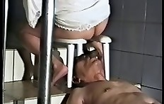 Young girl feed old male slave with her poop