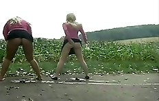 Two girls shitting and peeing together