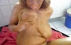 Scat smearing busty lady