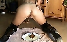 Scat domina shitting and pissing on plate