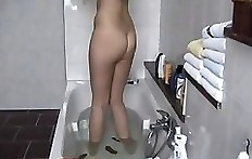 Young woman shitting in bath