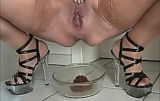 Pissing and pooping hot lady
