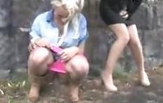 Three beautiful girls went under the bridge to pee