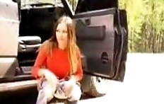 Woman pissing near the jeep