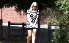 Pee girl near the fence