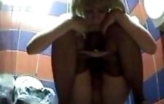 Leggy blonde pooping in the toilet with a hidden camera