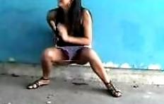 Beautiful brunette pissing under the bridge