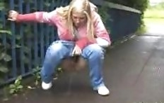 A girl in a pink jacket pee on the bridge