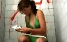 A girl in a green bikini pooping