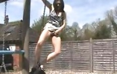 Girl pissing on the playground