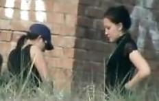 Brunette in a blue baseball cap shit