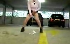 The girl pisses in the underground parking