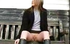 Girl pee sitting on the bench