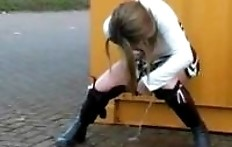 Woman pissing in the yellow container