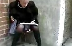 Blonde pissing in the underpass