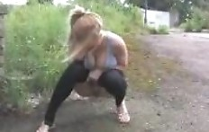 Busty girl pissing on the street