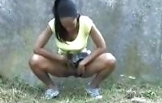 Black girl pissing near the road