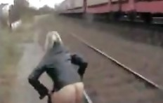 The girl shit and pissing on the railway