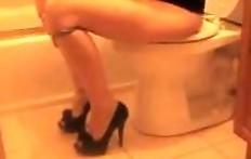 Cutie pooping in the toilet 2
